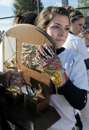 Legacy's Shae Rodriguez carries the state 5A championship trophy  after winning the state 5A softball championship against Rock Canyon on Saturday at the Aurora Sports Complex. Legacy defeated Rock Canyon 5-2.<br /> <br /> October 23, 2010<br /> staff photo/David R. Jennings