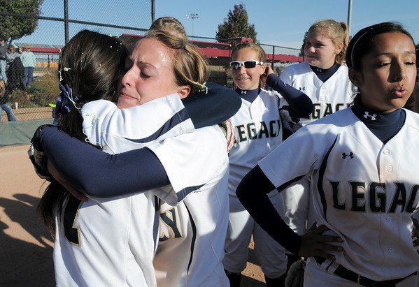 Legacy's Melissa Marcovecchio hugs Shae Rodgriguez after winning the state 5A softball championship on Saturday at the Aurora Sports Complex. Legacy defeated Rock Canyon 5-2.<br /> <br /> October 23, 2010<br /> staff photo/David R. Jennings