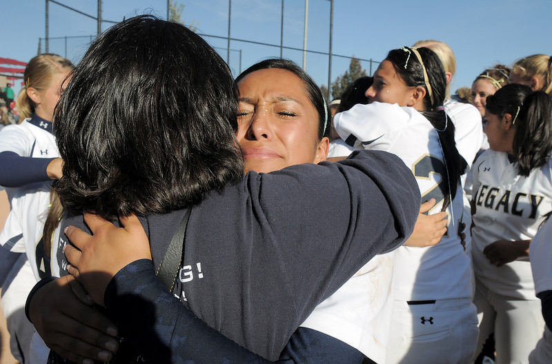 Marisa Cordova, Legacy's third baseman, receives a hug after winning the state 5A softball championship on Saturday at the Aurora Sports Complex. Legacy defeated Rock Canyon 5-2.<br /> <br /> October 23, 2010<br /> staff photo/David R. Jennings