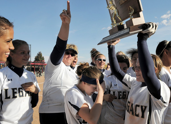 Legacy celebrates with coach Dawn Gaffin while Melissa Marcovecchio holds up the state 5A softball championship trophy on Saturday at the Aurora Sports Complex. Legacy defeated Rock Canyon 5-2.<br /> <br /> October 23, 2010<br /> staff photo/David R. Jennings
