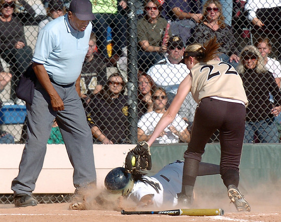 Legacy's Rainey Gaffin tries to get past the glove of Rock Canyon's Melanie White at home plate during Saturday's championship game against Rock Canyon at the Aurora Sports Complex. <br /> <br /> <br /> October 23, 2010<br /> staff photo/David R. Jennings