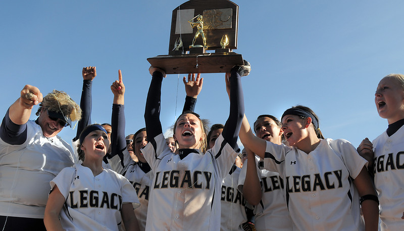 Melissa Marcovecchio, center, holds the state 5A championship softball trophy while the team cheers for Legacy's fourth championship in a row at the Aurora Sports Complex on Saturday defeating Rock Canyon 5-2. <br /> <br /> October 23, 2010<br /> staff photo/David R. Jennings