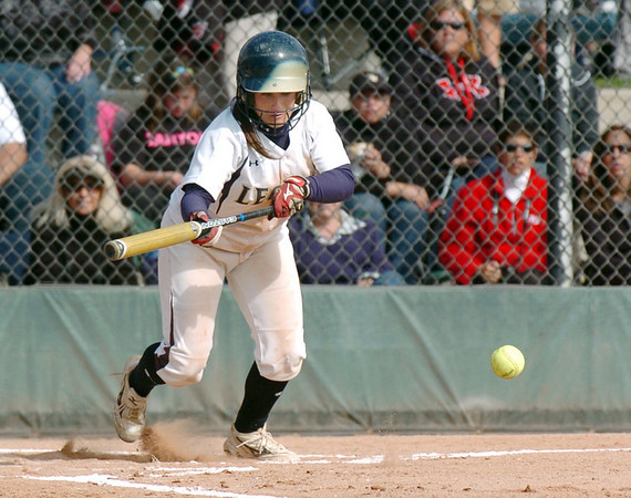 Legacy's Jessica Ball bunts the ball during Saturday's championship game against Rock Canyon at the Aurora Sports Complex. <br /> October 23, 2010<br /> staff photo/David R. Jennings