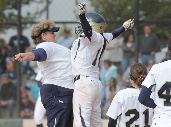 Legacy's catcher Buggs Torrez celebrates with coach Dawn Gaffin after Torrez hit a home run against  Ralston Valley during the state semi final 5A softball championship game on Saturday at the Aurora Sports Complex. <br /> <br /> October 23, 2010<br /> staff photo/David R. Jennings