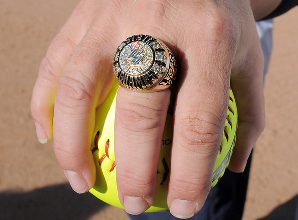 Legacy coach Dawn Gaffin holds the game ball while wearing one of the championship rings after the team won it's 4th state 5A softball championship on Saturday against Rock Canyon at the Aurora Sports Complex. <br /> <br /> October 23, 2010<br /> staff photo/David R. Jennings
