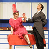 "Audrey Felderman as Mrs. Trottendale takes the hand of Paul Hunter as Underling her butler during Friday's rehearsal of Legacy High's production of ""The Drowsy Chaperone"".<br /> February 4, 2011<br /> staff photo/David R. Jennings"