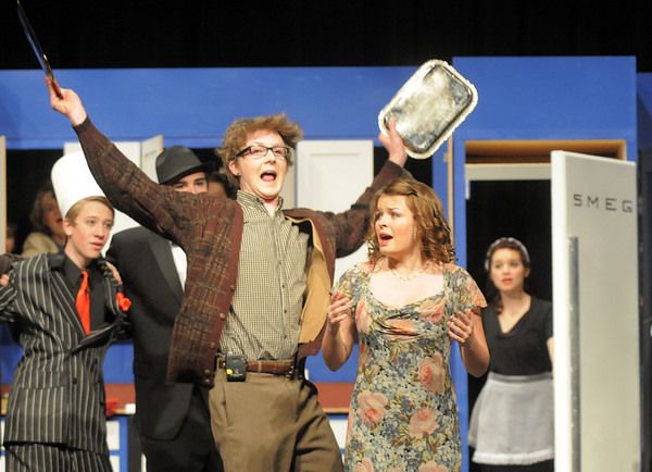 """Wil Vickroy as the Man in the Chair bangs metal platers together for a dramatic moment while Haley DiVirgilio as Janet Van De Graaff sings during Friday's rehearsal of Legacy High's production of """"The Drowsy Chaperone"""".<br /> February 4, 2011<br /> staff photo/David R. Jennings"""