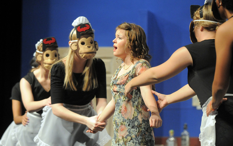 "Haley DiVirgilio as Janet Van De Graaff sings the monkey song with maids during Friday's rehearsal of Legacy High's production of ""The Drowsy Chaperone"".<br /> February 4, 2011<br /> staff photo/David R. Jennings"