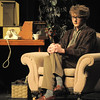 "Wil Vickroy as the Man in the Chair narrates through the musical preformances during Friday's rehearsal of Legacy High's production of ""The Drowsy Chaperone"".<br /> February 4, 2011<br /> staff photo/David R. Jennings"