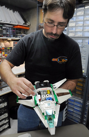 Duane Hess works on a Lego space ship he built with Legos in his home studio on Wedensday. Hess belongs to a local Lego club.<br /> Sept. 2, 2009<br /> staff photo/David R. Jennings