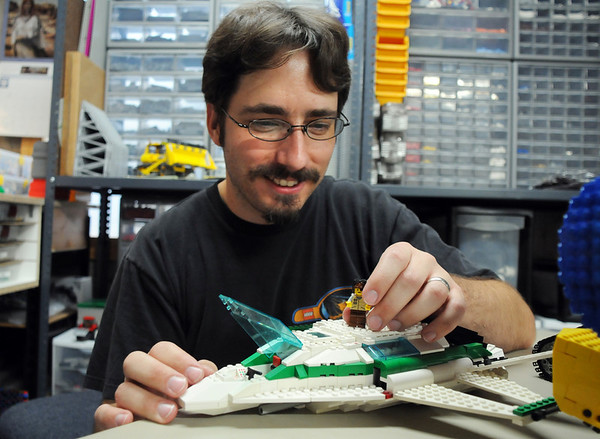 Duane Hess shows the pilot of the Lego space ship he built from scratch at his home studio on Wednesday. Hess belongs to a local Lego club.<br /> Sept. 2, 2009<br /> staff photo/David R. Jennings