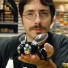 Duane Hess holds a bug he built with Legos at his home studio.<br /> Sept. 2, 2009<br /> staff photo/David R. Jennings