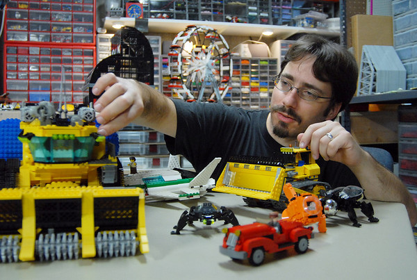BE0906LEGO01<br /> Duane Hess makes an adjustment to his Lego Lunar Ice Harvester he built on display with other pieces he's made at his home studio.  <br /> Sept. 2, 2009<br /> staff photo/David R. Jennings