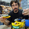 Duane Hess works his Lego Lunar Ice Harvester he built from scratch at his home studio.<br /> Sept. 2, 2009<br /> staff photo/David R. Jennings