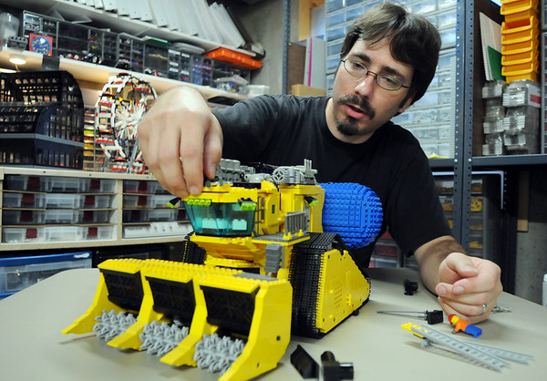 Duane Hess works on a Lunar Ice Harvester Lego model he built from scratch at his home on Wedensday. Hess belongs to a local Lego club.<br /> Sept. 2, 2009<br /> staff photo/David R. Jennings