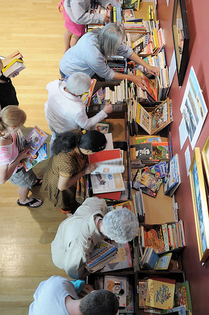 LIbrary patrons look through the children's books at the Broomfield Library Friends book sale at the Mame Doud Eisenhower Public Library on Saturday.  <br /> March 31, 2012 <br /> staff photo/ David R. Jennings