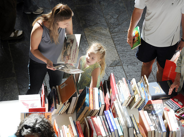 Erin Fernandez, left, and her daughter Madeleine, 6, look for books at the Broomfield Library Friends book sale at the Mame Doud Eisenhower Public Library on Saturday.  <br /> March 31, 2012 <br /> staff photo/ David R. Jennings