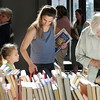 Erin Fernandez, center, and her daughter Madeleine, 6, with Bev Sharp, right, look through books at the Broomfield Library Friends book sale at the Mame Doud Eisenhower Public Library on Saturday.  <br /> March 31, 2012 <br /> staff photo/ David R. Jennings