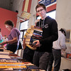 Josh Gaines carries a stack of books while looking for more books to by at the Broomfield Library Friends book sale at the Mame Doud Eisenhower Public Library on Saturday.  <br /> March 31, 2012 <br /> staff photo/ David R. Jennings