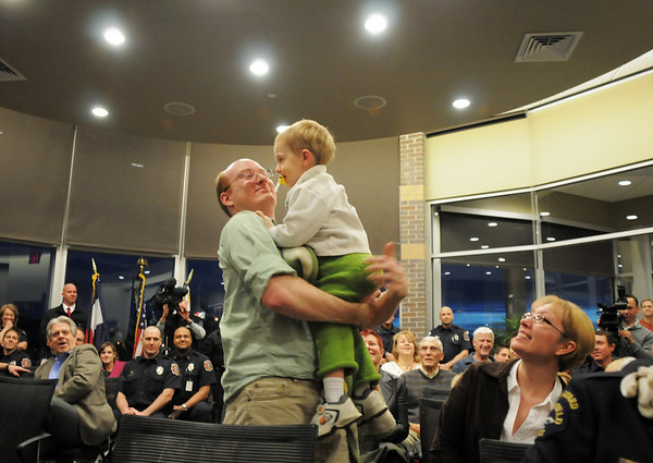 Christopher Floyd holds his son David, 2, before the ceremony presenting Broomfield Police Sergeant Neil Martinez with the North Metro Fire Rescue District Citizen Life Saving Award for saving David life in December.<br /> January 18, 2011<br /> staff photo/David R. Jennings