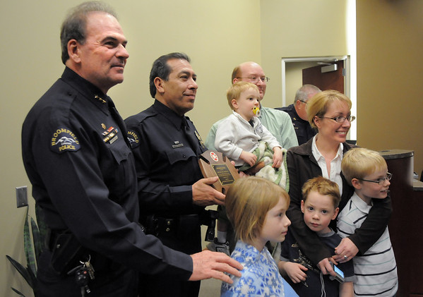 Broomfield Chief Tom Deland and Sergeant Neil Martinez pose with the Floyd Family after Martinez was presented with the North Metro Fire Rescue District Citizen Life Saving Award  for saving David Floyd's life last December.<br /> January 18, 2011<br /> staff photo/David R. Jennings