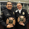Broomfield Police Sergeant Neil Martinez, left, and Officer Kathryn Holsopple pose with their North Metro Fire Rescue District Citizen Life Saving Awards at North Metro Headquarters on Tuesday<br /> January 18, 2011<br /> staff photo/David R. Jennings