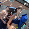 Beginning their day, lifeguards Megan Claussen, right, and Grayson Malcolm walk to their stations at The Bay Aquatic Center on Friday.<br /> <br /> July 13, 2012<br /> staff photo/ David R. Jennings
