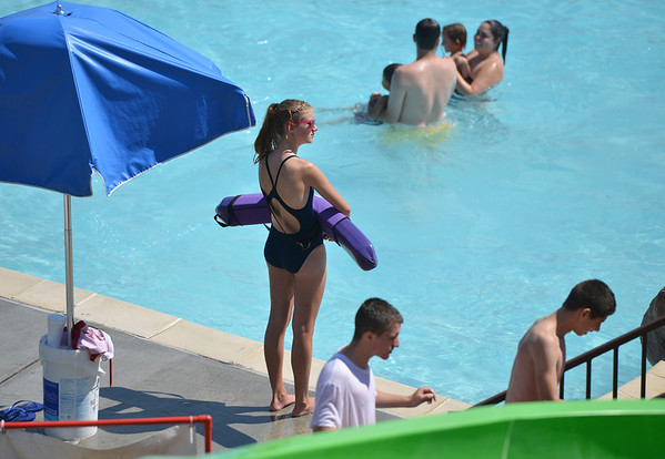 Lifeguard Fallyn Reed, 15, watches the swimmers from her station at The Bay Aquatic Center on Friday.<br /> <br /> July 13, 2012<br /> staff photo/ David R. Jennings