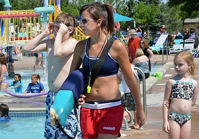 Lifeguard Megan Claussen, 20, walks the edge of the pool while watching swimmers at The Bay Aquatic Center on Friday.  July 13, 2012 staff photo/ David R. Jennings