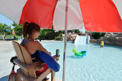 Megan Claussen, 20, watches swimmers in the children's pool from her lifeguard station at The Bay Aquatic Center on Friday. Lifeguards have to be on duty even if there's only one person is in the pool.  July 13, 2012 staff photo/ David R. Jennings