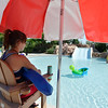 Megan Claussen, 20, watches swimmers in the children's pool from her lifeguard station at The Bay Aquatic Center on Friday. Lifeguards have to be on duty even if there's only one person is in the pool.<br /> <br /> July 13, 2012<br /> staff photo/ David R. Jennings