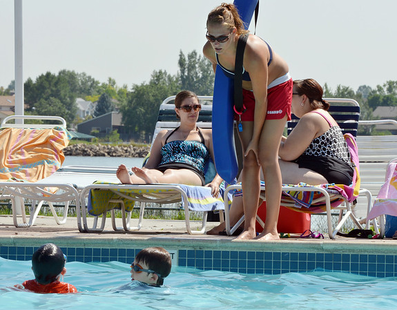 Lifeguard Alissa Johnson, 18, talks to a couple of swimmers in the pool at The Bay Aquatic Center on Friday.<br /> <br /> July 13, 2012<br /> staff photo/ David R. Jennings