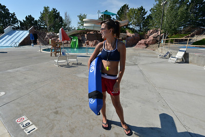 Lifeguard Megan Claussen, 20, prepares to begin her day at The Bay Aquatic Center on Friday.  July 13, 2012 staff photo/ David R. Jennings