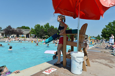 Lifeguard Megan Claussen, 20, watches the swimmers in the pool at The Bay Aquatic Center on Friday.  July 13, 2012 staff photo/ David R. Jennings