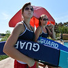 Megan Classen, 20, left, is briefed by Alissa Johnson, 18, during the lifeguard rotation every 20 minutes  at The Bay Aquatic Center on Friday.<br /> <br /> July 13, 2012<br /> staff photo/ David R. Jennings