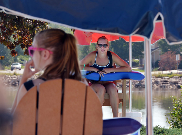 Lifeguards Alissa Johnson, 18, right, and Fallyn Reed, 15, left, keep their eyes on people playing in the water at The Bay Aquatic Center on Friday.<br /> <br /> July 13, 2012<br /> staff photo/ David R. Jennings