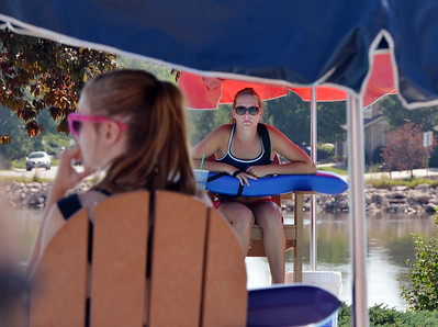 Lifeguards Alissa Johnson, 18, right, and Fallyn Reed, 15, left, keep their eyes on people playing in the water at The Bay Aquatic Center on Friday.  July 13, 2012 staff photo/ David R. Jennings