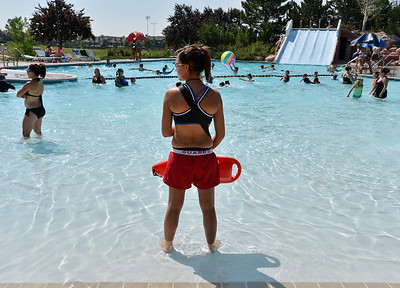 Lifeguard Megan Claussen, 20, watches from her station at The Bay Aquatic Center on Friday.  July 13, 2012 staff photo/ David R. Jennings