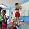 Megan Claussen, 20, stands on a chair to log which station she will begin her lifeguard duties  at The Bay Aquatic Center on Friday.<br /> <br /> July 13, 2012<br /> staff photo/ David R. Jennings