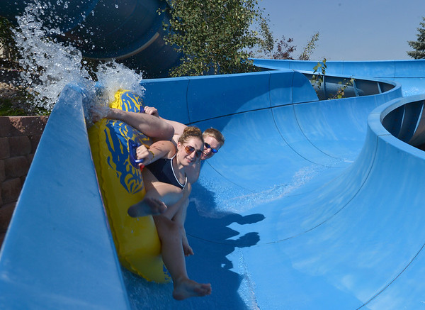 Lifeguards Kelsey Cordutsky, 18, and Bryan Harp, 26, take the first trip down the tube slide to begin the day at The Bay Aquatic Center on Friday.<br /> <br /> July 13, 2012<br /> staff photo/ David R. Jennings