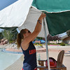 Alissa Johnson, 18, adjusts an umbrella at her  lifeguard station at The Bay Aquatic Center on Friday.<br /> <br /> July 13, 2012<br /> staff photo/ David R. Jennings