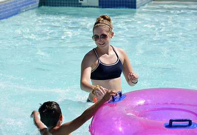Lifeguard Kelsey Cordutsky, 18, catches tubes from the tube slide at The Bay Aquatic Center on Friday.  July 13, 2012 staff photo/ David R. Jennings