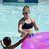 Lifeguard Kelsey Cordutsky, 18, catches tubes from the tube slide at The Bay Aquatic Center on Friday.<br /> <br /> July 13, 2012<br /> staff photo/ David R. Jennings