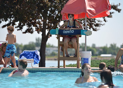 Lifeguard Megan Claussen, 20, watches adults and children playing in the big  pool at The Bay Aquatic Center on Friday.  July 13, 2012 staff photo/ David R. Jennings