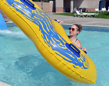 Lifeguard Kelsey Cordutsky, 18, tosses a tube from the splash pool of the tube slide at The Bay Aquatic Center on Friday.  July 13, 2012 staff photo/ David R. Jennings