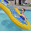 Lifeguard Kelsey Cordutsky, 18, tosses a tube from the splash pool of the tube slide at The Bay Aquatic Center on Friday.<br /> <br /> July 13, 2012<br /> staff photo/ David R. Jennings