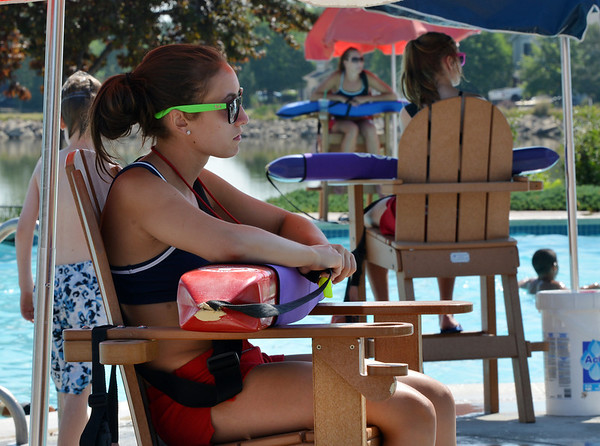 Lifeguards Maddie Smith, 16, left, Alissa Johnson, 18, and Fallyn Reed, 15, watch swimmers from their stations at The Bay Aquatic Center on Friday.<br /> <br /> July 13, 2012<br /> staff photo/ David R. Jennings