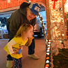 Alice Walker, 3, with John Weibert, right, looks at Kim Weibert's holiday lighting display at x1188 Clubhouse Drive in Broomfield.<br /> December 6, 2012<br /> staff photo/ David R. Jennings