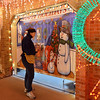 Kim Weibert checks the mural on the garage for her holiday lighting display at 1188 Clubhouse Drive in Broomfield.<br /> December 6, 2012<br /> staff photo/ David R. Jennings