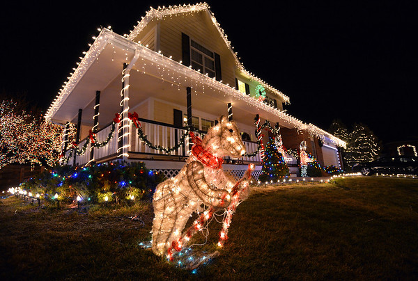 A skiing bear is part of the holiday lighting display at  4755 W. 128th Place in Broomfield.<br /> December 8, 2012<br /> staff photo/ David R. Jennings